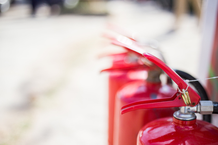 Foto de Red fire extinguisher - Imagen libre de derechos