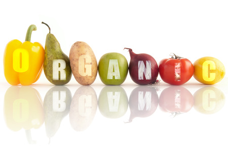 Photo for Organic word written using a row of fruits and vegetables over a white background - Royalty Free Image