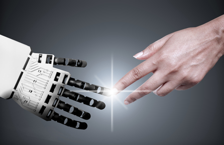 Photo for Robot and human touching forefingers - Royalty Free Image