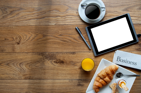 Photo for Business breakfast with digital tablet on a wooden background with space - Royalty Free Image