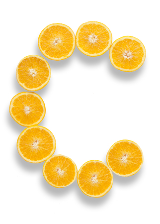 Photo pour Vitamin C letter made from orange halves over a white background - image libre de droit