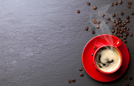 Foto für coffee cup with coffee beans background - Lizenzfreies Bild