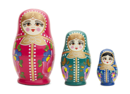 Three Traditional Russian Wood Dolls Isolated on White Background.