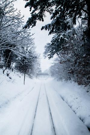 Foto de White Snow covered tracks on Tsugaru railway line in Aomori, Tohoku, Japan - Imagen libre de derechos