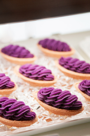 Photo for Famous Okinawa Beni Imo tart or sweet purple yam tart, beautiful arrange on tray - Royalty Free Image