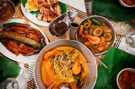 Photo pour Meal set of various traditional Filippino Food,  Pakbet, lechon kawali, Bale Dutung. Top view - image libre de droit