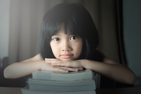 Photo for A little girl reading the book - Royalty Free Image