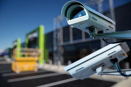 Foto de security CCTV camera or surveillance system with construction site on blurry background - Imagen libre de derechos