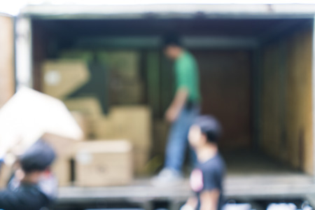 Photo for Blurred image of workers lifted carton from the truck, for background uses - Royalty Free Image