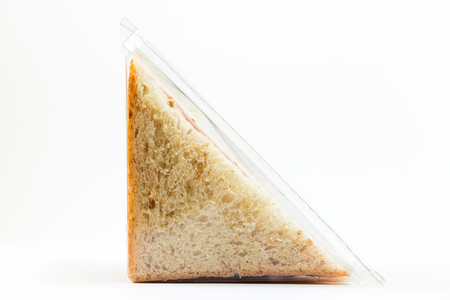 Foto de Whole wheat sandwich toast with ham and cheese in a plastic box isolated on white background - Imagen libre de derechos