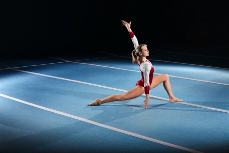 Photo pour portrait of young gymnasts competing in the stadium - image libre de droit