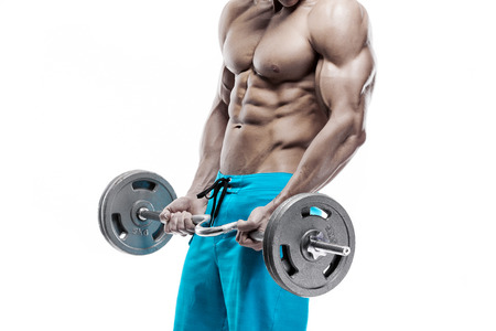 Photo for Muscular bodybuilder guy doing exercises with dumbbells isolated over white background - Royalty Free Image