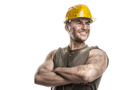 Foto de portrait of dirty worker with helmet crossed arms isolated on white background - Imagen libre de derechos