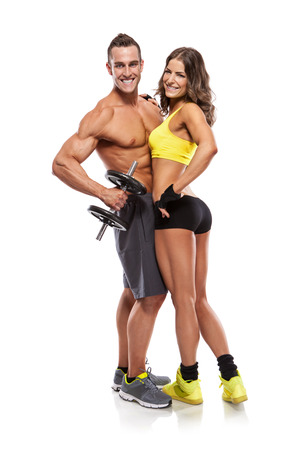 Photo for beautiful fitness young sporty couple with dumbbell isolated over white background - Royalty Free Image