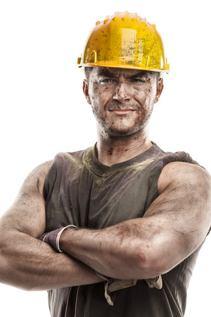 Photo pour portrait of dirty worker with helmet crossed arms isolated on white background - image libre de droit