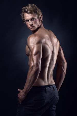 Photo for Strong Athletic Man Fitness Model posing back muscles, triceps, latissimus - Royalty Free Image