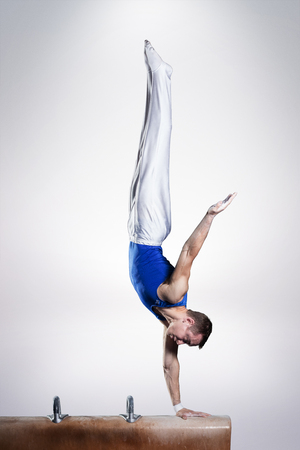 Foto de portrait of young man gymnasts competing in the stadium - Imagen libre de derechos