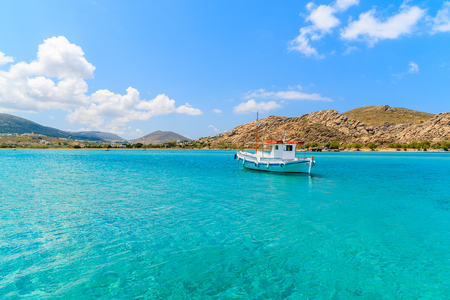 Photo for Typical Greek fishing boat sailing on turquoise sea water on Paros island, Greece - Royalty Free Image