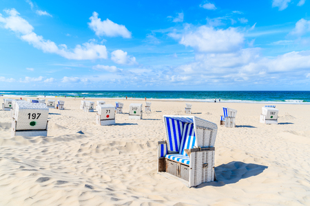 Photo for Chairs on white sand beach in Kampen village, Sylt island, Germany - Royalty Free Image
