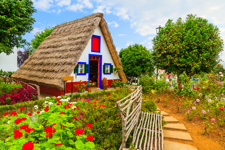 Photo for Traditional rural house with straw roof in Santana village, Madeira island, Portugal - Royalty Free Image