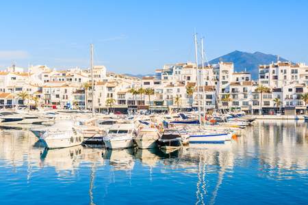 Foto de View of Puerto Banus marina with boats and white houses in Marbella town at sunrise, Andalusia, Spain - Imagen libre de derechos