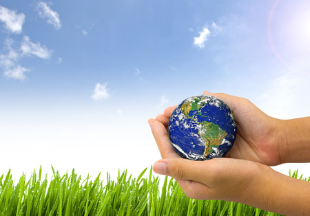 Foto de Earth planet the hand on nature and blue sky background - Corporate social responsibility concept. - Elements of this image furnished by NASA - Imagen libre de derechos