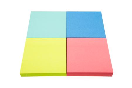 Foto de Four color block of paper notes isolated on white background - Imagen libre de derechos