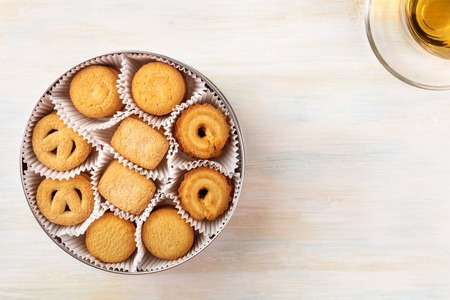 Foto de Overhead view of Danish butter cookies with tea and copyspace - Imagen libre de derechos