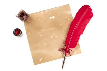 Photo pour An overhead photo of an ink well with a piece of old paper, with a red quill and copy space, shot from above on a white background - image libre de droit