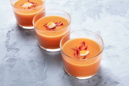 Photo for Salmorejo, Spanish chilled tomato and bread soup, served in glasses, with a place for text - Royalty Free Image
