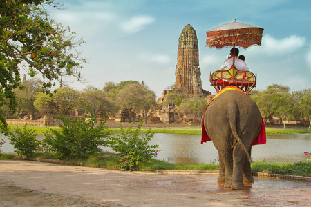 Photo for Tourists on an elephant ride tour of the ancient city Ayutaya ,thailand - Royalty Free Image