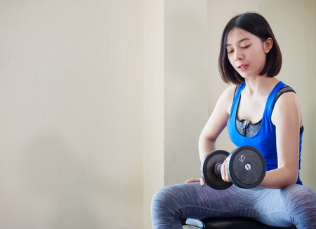 Foto per Young Asian woman training weight lifting at gym,  - Immagine Royalty Free