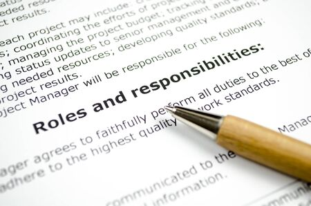 Foto per Roles and responsibilities with wooden pen - Immagine Royalty Free