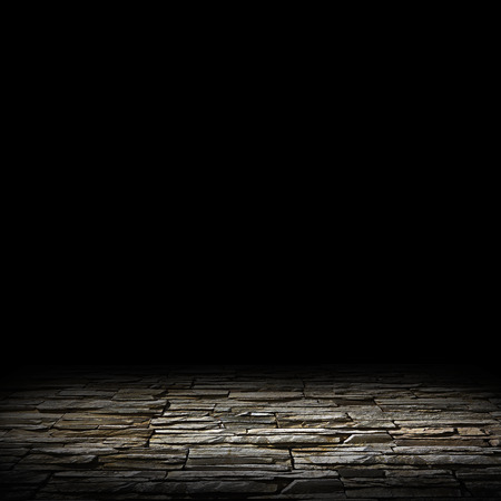 Photo pour illuminated stone floor on a black background - image libre de droit