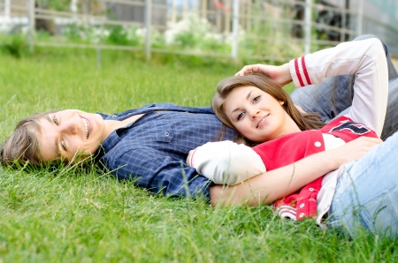 Handsome man and woman lying in the grass