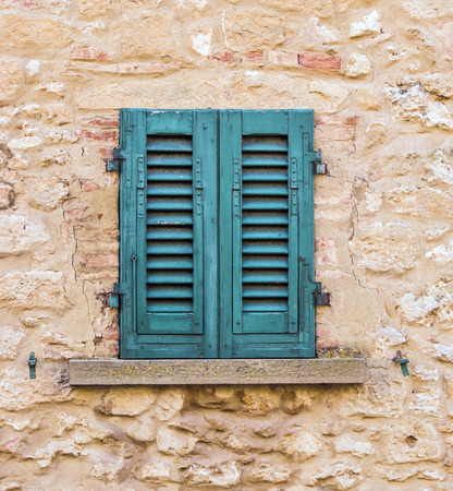 old windows of an ancient historic building with brick and stone masonry