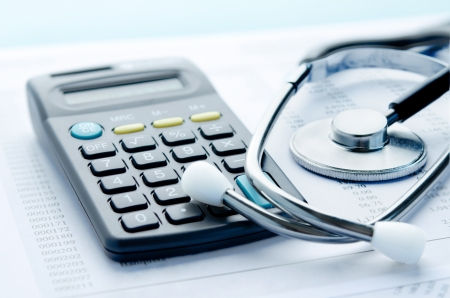 Health care costs  Stethoscope and money symbol for health care costs or medical insurance