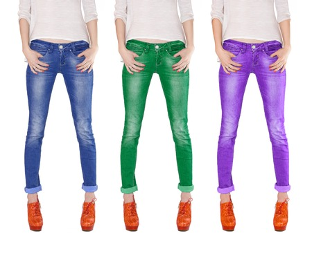 Photo for Shapely female legs dressed in blue, green and violet jeans - Royalty Free Image