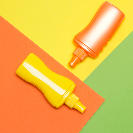 Photo pour Suntan lotions on multi-colored blocks. Bright summer design - image libre de droit