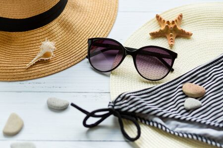 Photo for Sunglasses, hat and swimsuit on a white background. Vacation on the beach. Flatlay, top wiew - Royalty Free Image