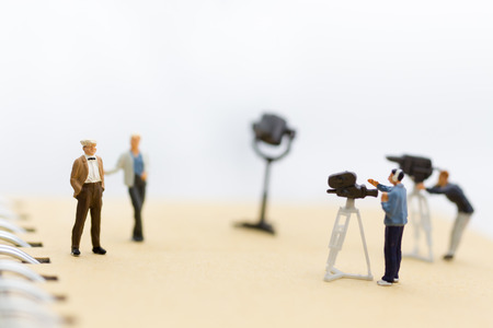 Photo for Miniature people : Small team of tv reporter with Celebrity Interviews, production television concept. - Royalty Free Image
