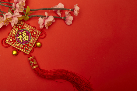 Foto de Chinese new year 2020 ornament on red paper with Chinese letter FU meaning meaning fortune or good luck, gold ingot, Chinese lamp - Imagen libre de derechos