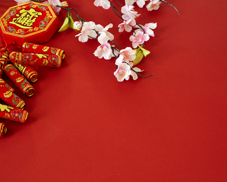 Foto de chinese new year 2019 festival decorations plum flowers on red  background (Chinese characters . in the article refer to good luck, wealth, money flow) Empty space for design - Imagen libre de derechos