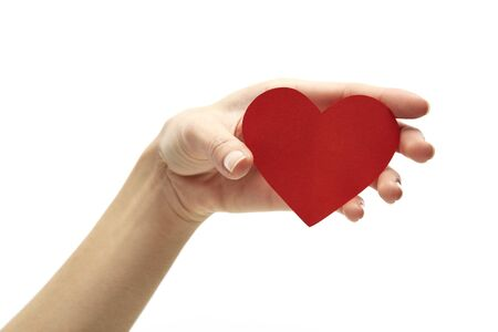 Photo for Female hand holding red paper heart - Royalty Free Image
