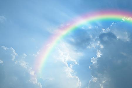 Foto de Blue sky and white cloud with sun light and rainbow - Imagen libre de derechos