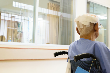 Photo pour Patient elderly man with head injury on wheelchair in hospital - image libre de droit
