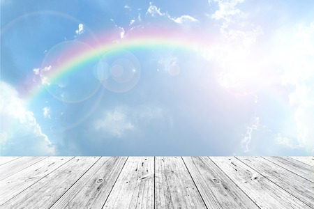 Foto de Wood terrace and Blue sky and white cloud with rainbow - Imagen libre de derechos