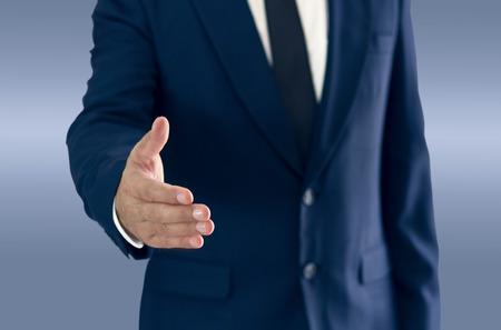 Foto de A businessman is standing and shaking hands. copy space for your text. - Imagen libre de derechos