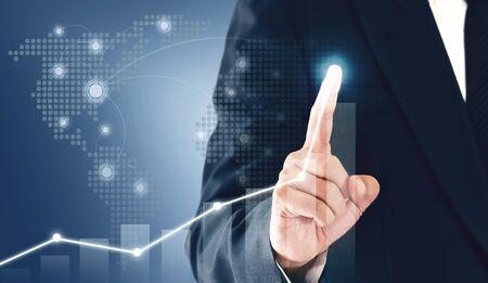 Photo pour Businessman showing business growth on a chart, hands touch the graph that represents profit rises on a lot more.  - image libre de droit