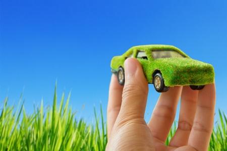 Photo pour  Eco car icon on blue sky background - image libre de droit